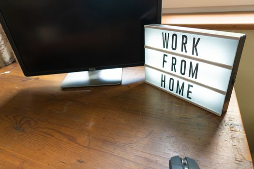 Working from home remote work inspirational social media lightbox message board next to laptop COVID-19 quarantine closure of all businesses.