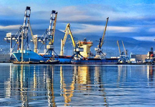 Port cranes in the port of Novorossiysk. Industrial port landscape.