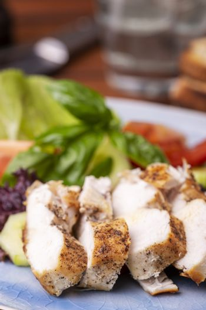 chicken breast slices on fresh salad