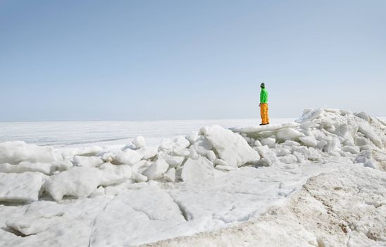 Young adult man outdoors exploring icy landscape