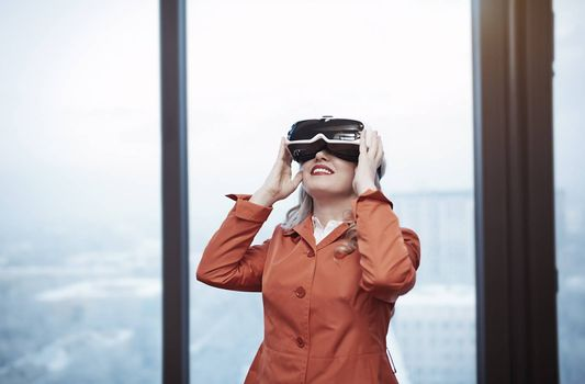 Woman at office wearing Virtual reality headset