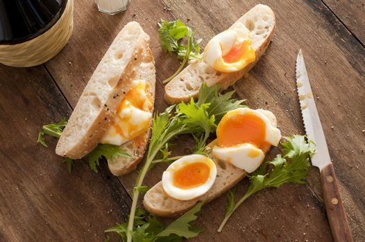 Bread with boiled eggs and salad