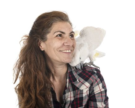 cockatoo and woman in front of white background