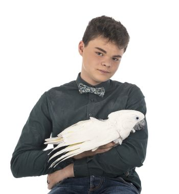 cockatoo and teen in front of white background