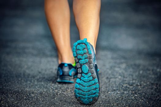 Active lifestyle, sporty female on a jog outdoor workout, closeup photo of the rear view of woman's legs, female wears sneakers, a healthy lifestyle, weight loss concept