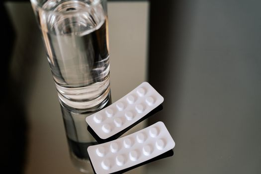 pills medicine tablets and glass of water, healthcare and medici