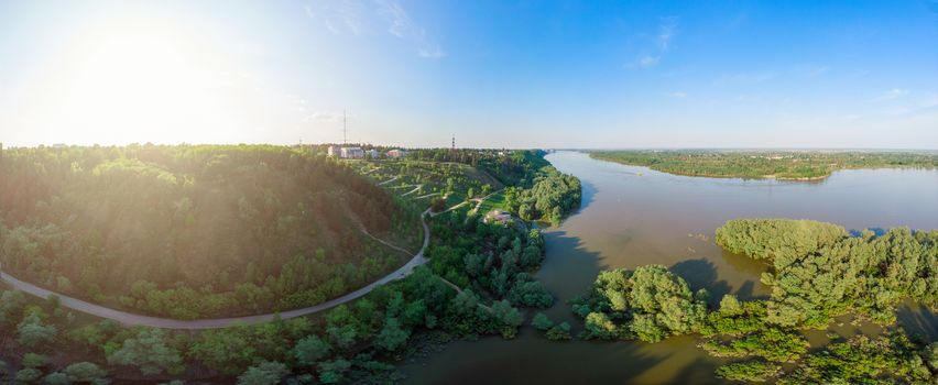Big horisontal drone panorama, aerial top vew of winding road in the city Barnaul with Ob river