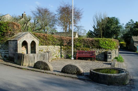 Very unusual well and trough in the village of Curbar. This was once the water supply for residents of this picturesque Peak District village