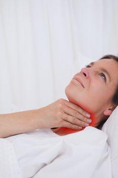 Woman rubbing her throat