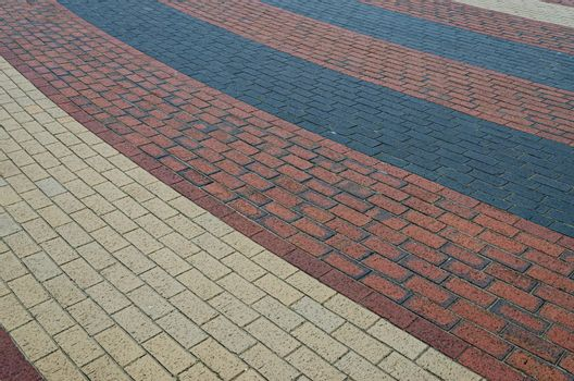 Interesting pattern of red black and beige bricks