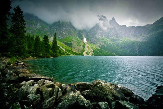Lake in mountains. Fantasy and colorfull nature landscape. Morskie Oko lake.