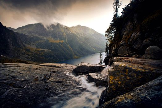 River in foggy mountains landscape. Nature in mountains.