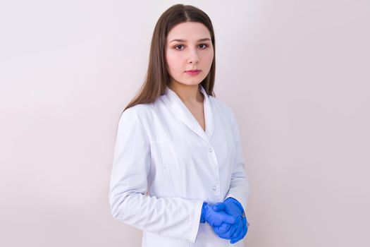Female doctor wearing protection gloves. Hygiene and Health.