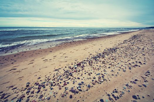 Cold sea in vintage colors. Water sky and beach.