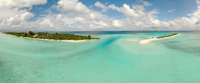 Picture perfect beach and turquoise lagoon on small tropical island on Maldives.
