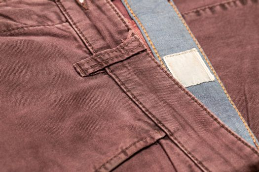 Dark cherry Denim Texture. Denim background of jeans of unusual color, place for text, place for copying.