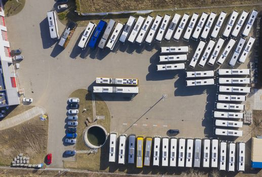 Aerial view to parking lot for autobus and trucks. Industrial background on transportation theme