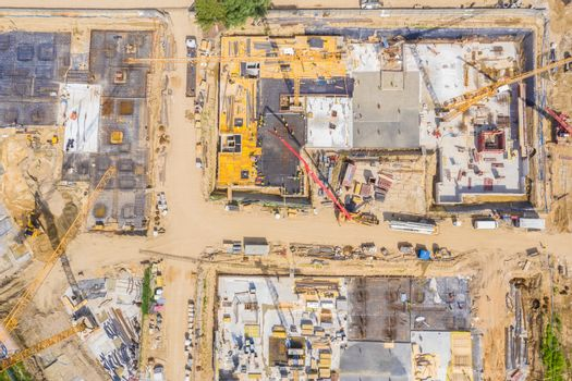 Aerial view of a new house building on a construction site.