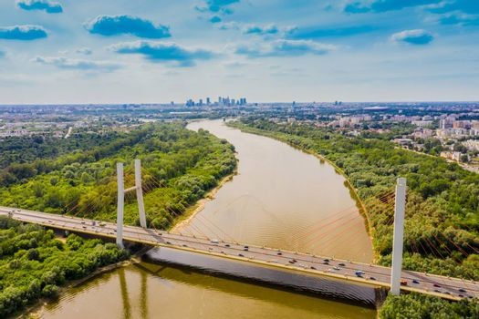 Drone view landscape highway bridge over river. Areal view city road landscape. Warsaw. Europe