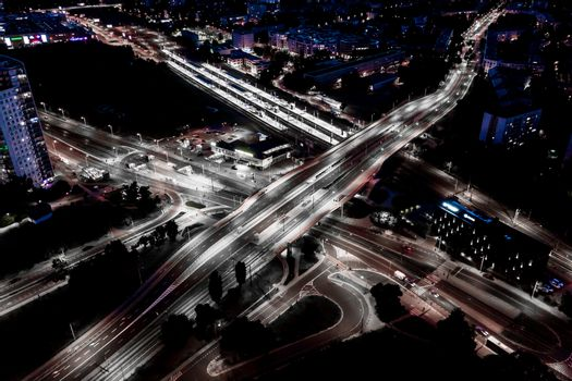 Aerial view Expressway motorway highway circus intersection at Night time Top view , Road traffic in city