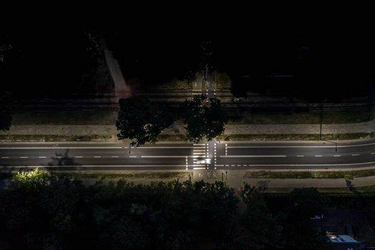 The light on the road at night and the city in Warsaw Road beautiful. Aerial view. Top view. Background scenic road. curves road drone