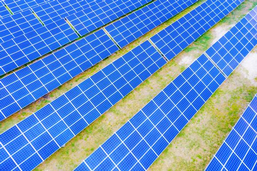 Solar panel, photovoltaic, alternative electricity source - concept of sustainable resources. Aerial view of Solar panels Photovoltaic systems industrial landscape