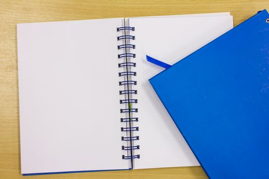 blue diary book on table office