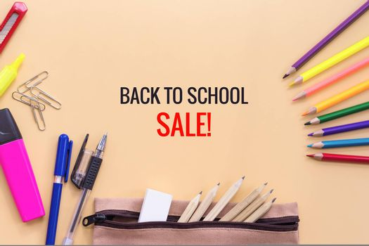 Welcome back to school sale background, colorful color pencil and stationery bag on yellow backgrounds with copy space