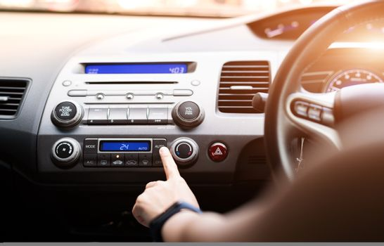 woman push turn on air condition in car