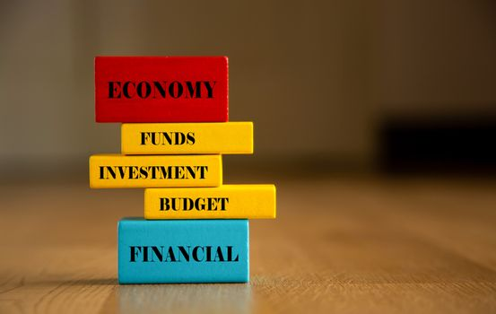 Invest conceptual word on wooden block