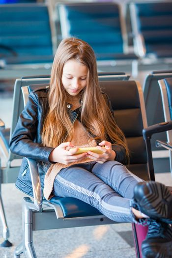 Girl in international airport waiting for boarding
