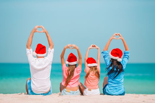 Beautiful family on christmas vacation in santa hat
