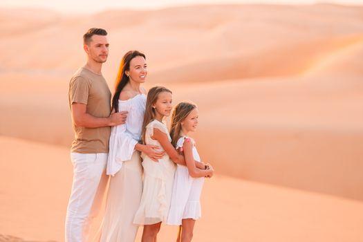 People among dunes in desert in United Arab Emirates