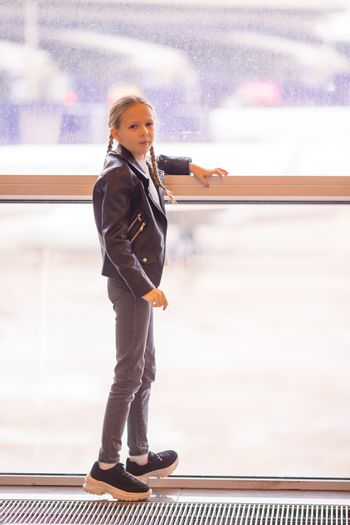 Adorable girl in international airport