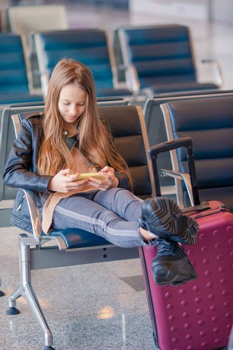 Portrait of girl in international airport