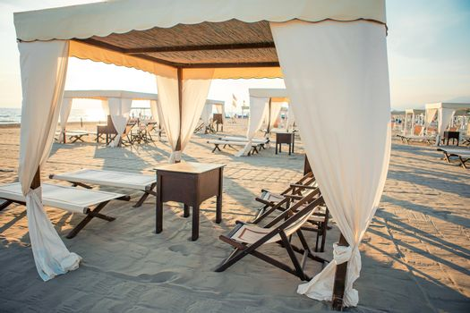 Luxury sun beds in the evening lights