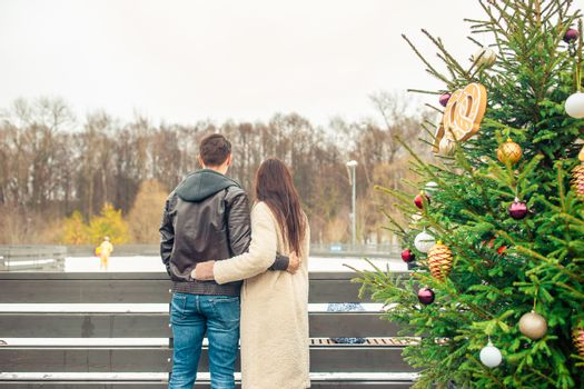 Back vie of couple looking at ice rink at winter