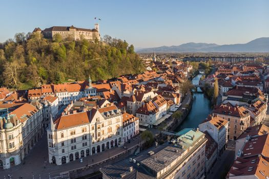 Aerial drone panoramic view of Ljubljana, capital of Slovenia in warm afternoon sun.