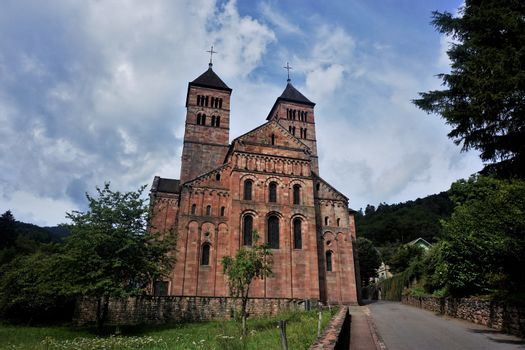 Footpath leading to the entrance of Murbach Abbey in the Vosges, France