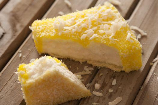Lemon flavored lamington on sponge cake