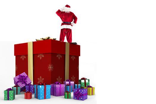 Santa standing on giant present