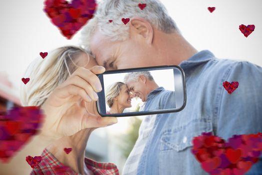 Composite of Couple taking Valentines selfie