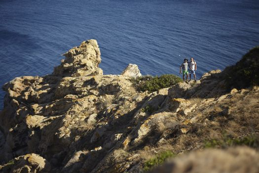 Capo Ferrato in Sardinia Landscape with people in excurion on the rocks