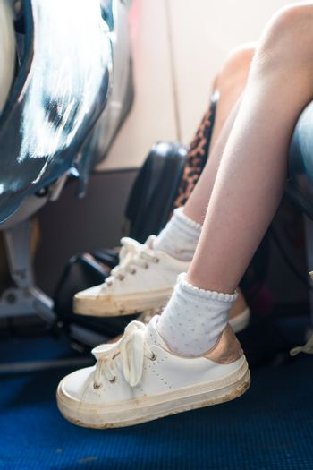 Closeup of baby feet on seat in the aircraft