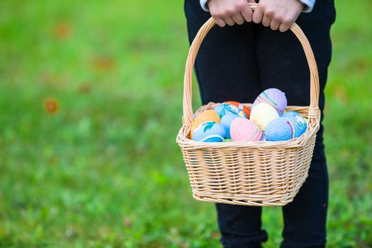 Child holding a basket with easter eggs