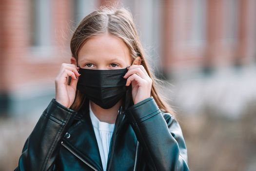 Girl wearing a mask protect against Coronavirus and gripp