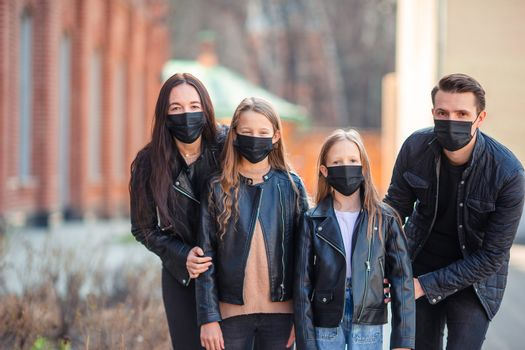 Family wearing masks to protect against Coronavirus and gripp