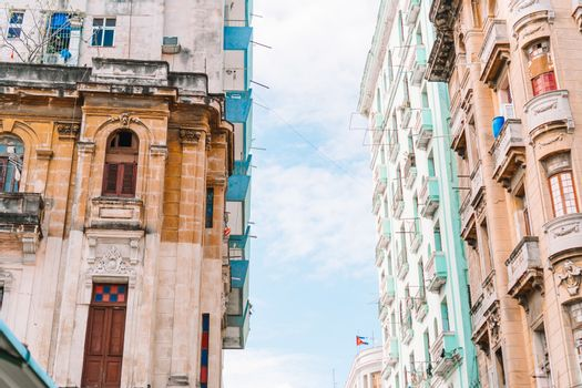 Authentic view of a street of Old Havana with old buildings and cars