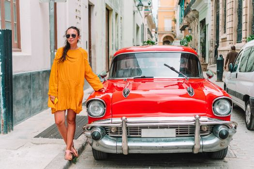 Tourist girl in popular area in Havana, Cuba. Back view of young woman traveler
