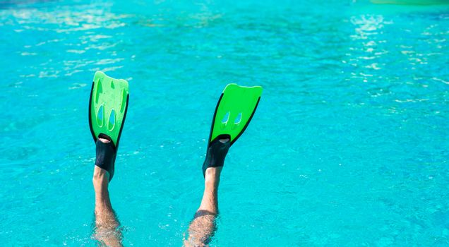 Close-up of fins in the turquoise water